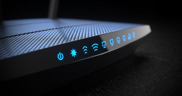 Wi-Fi wireless internet router on dark background