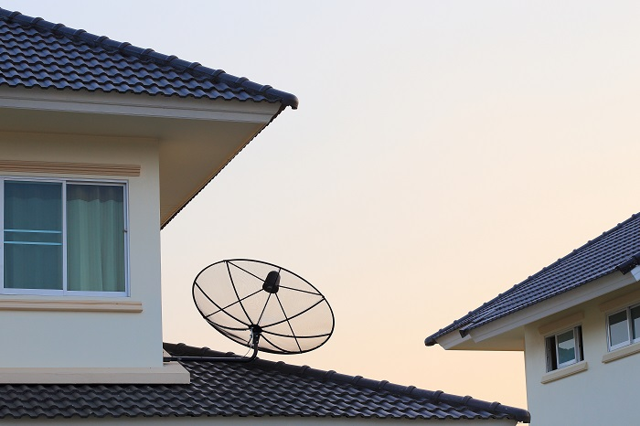 A picture containing Satellite dish and TV antennas on the house roof Best Business Internet Providers