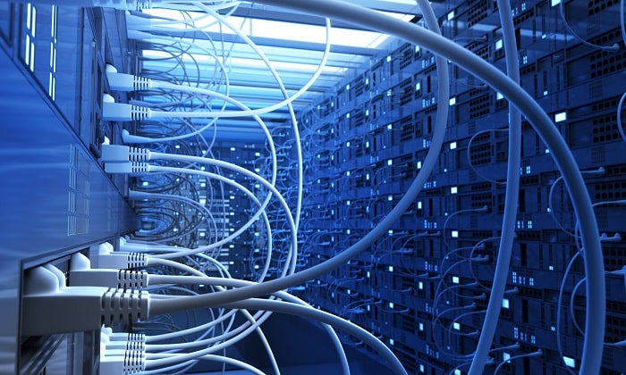 How to start internet service provider business? telecommunication racks, cables and ports in a server room.