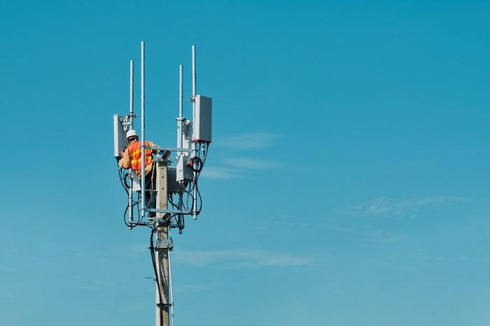 Technician on the telecommunication antenna tower